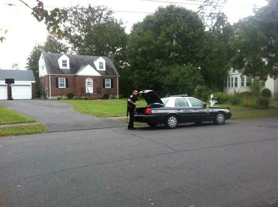 Police investigate a burglary on Arbor Drive in Fairfield, Conn. on Tuesday, Oct. 4, 2011. The burglary was one of two during the day in the town's Southport section, police said. Photo: Tom Cleary