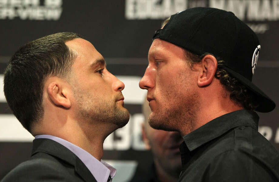 UFC Lightweight Champion Frankie Edgar, left, and challenger Gray Maynard face off Wednesday at the UFC 136 pre-fight press conference at the Toyota Center. Photo: Josh Hedges/Zuffa LLC