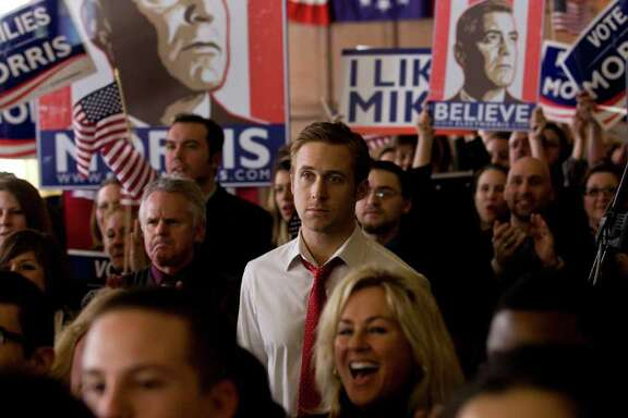 """Stephen (Ryan Gosling, center) is a cool, self-assured worker for a liberal governor running for president in """"Ides of March."""" COLUMBIA PICTURES"""