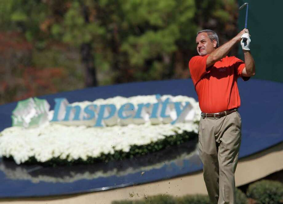 Andy Stepka, who was paired with pro golfer Chip Beck, tees off on the 14th hole during the Woodforest National Bank Championship Pro-Am at the Insperity Championship. Photo: Karen Warren, Houston Chronicle / © 2011 Houston Chronicle