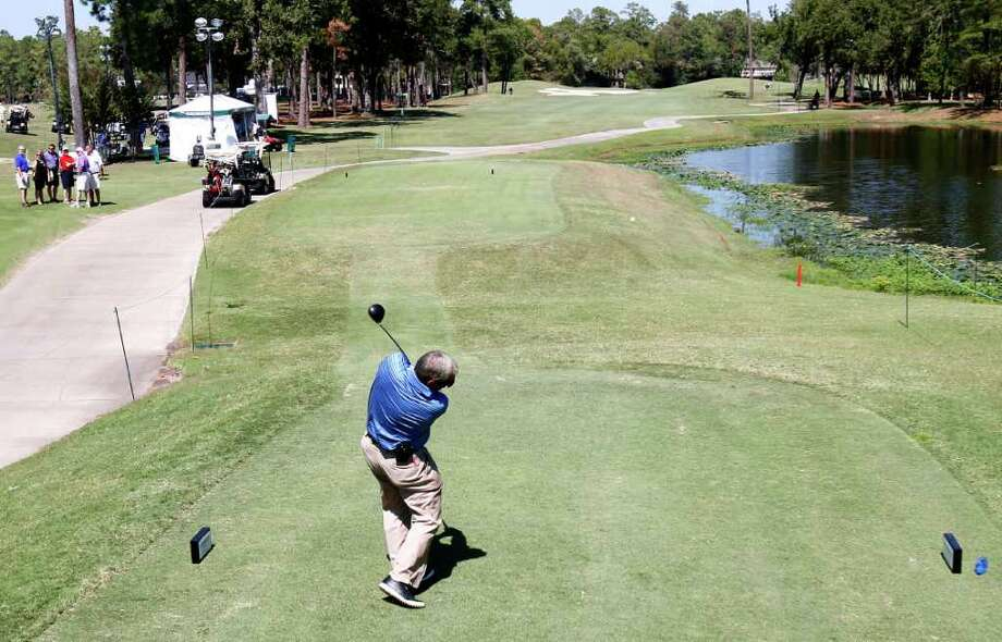 Fuzzy Zoeller tees off on the 1st hole during the Woodforest National Bank Championship Pro-Am at the Insperity Championship at The Woodlands Country Club,Wednesday, Oct. 5, 2011, in The Woodlands. Photo: Karen Warren, Houston Chronicle / © 2011 Houston Chronicle