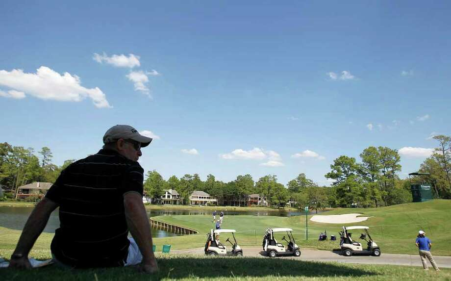 John Lane watches golfers on the 17 hole. Photo: Karen Warren, Houston Chronicle / © 2011 Houston Chronicle