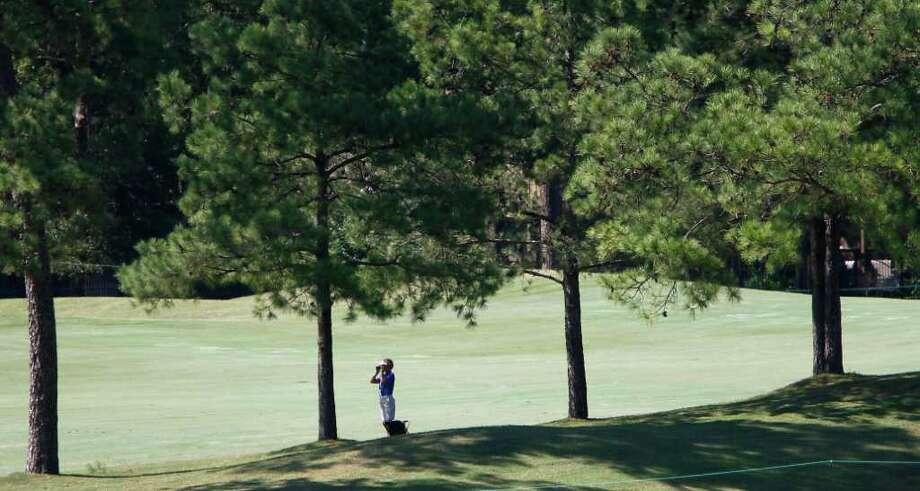 A volunteer marshal watches golfers on the back nine. Photo: Karen Warren, Houston Chronicle / © 2011 Houston Chronicle
