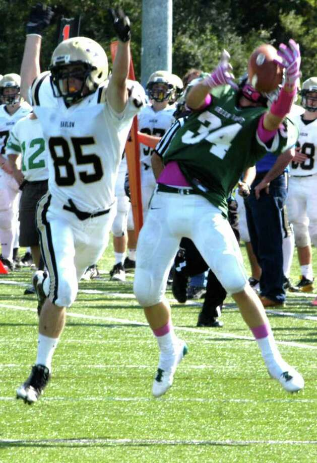 SPECTRUM/Green Wave junior Tevan Leonard makes a circus catch for the NMHS defense's fourth interception of the day as New Milford High School football scored its first victory of the 2011 campaign with a 28-9 'W' over Joel Barlow, Sunday, Oct. 2, 2011 in Brookfield. Photo: Norm Cummings