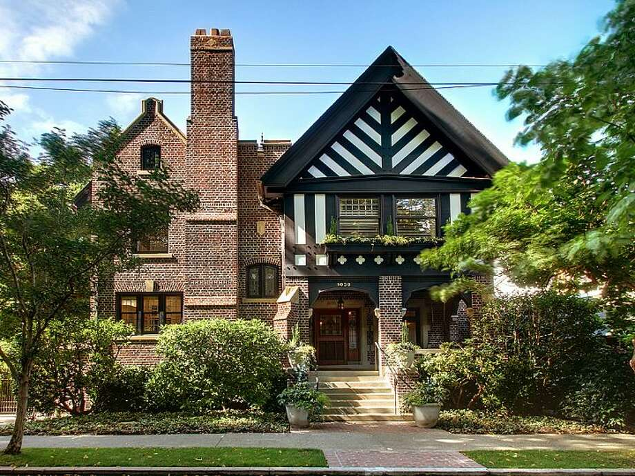 This 1913 brick tudor is one of the most sumptuous homes on Capitol Hill. The 8,243-square-foot house, at 1039 Belmont Place E., has five bedrooms, 6.25 bathrooms, dark-stained wood moldings, beams and paneling, five fireplaces and distinctive windows and ceilings, and sits on a 14,400-square-foot lot with views of Lake Union, Puget Sound and the Olympic Mountains. It's listed for $3.8 million. Photo: Windermere Real Estate