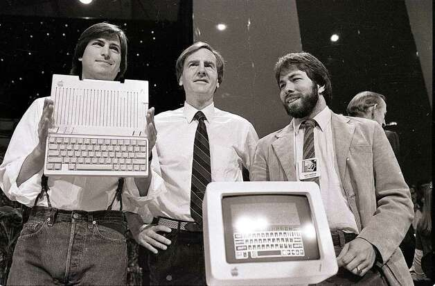 FILE - In this April 24, 1984 file photo, Steve Jobs, left, chairman of Apple Computers, John Sculley, center, then president and CEO, and Steve Wozniak, co-founder of Apple, unveil the new Apple IIc computer in San Francisco. Apple Inc. on Wednesday, Aug. 24, 2011 said Jobs is resigning as CEO, effective immediately. He will be replaced by Tim Cook, who was the company's chief operating officer. It said Jobs has been elected as Apple's chairman.  (AP Photo/Sal Veder, File) Photo: SAL VEDER / AP1984