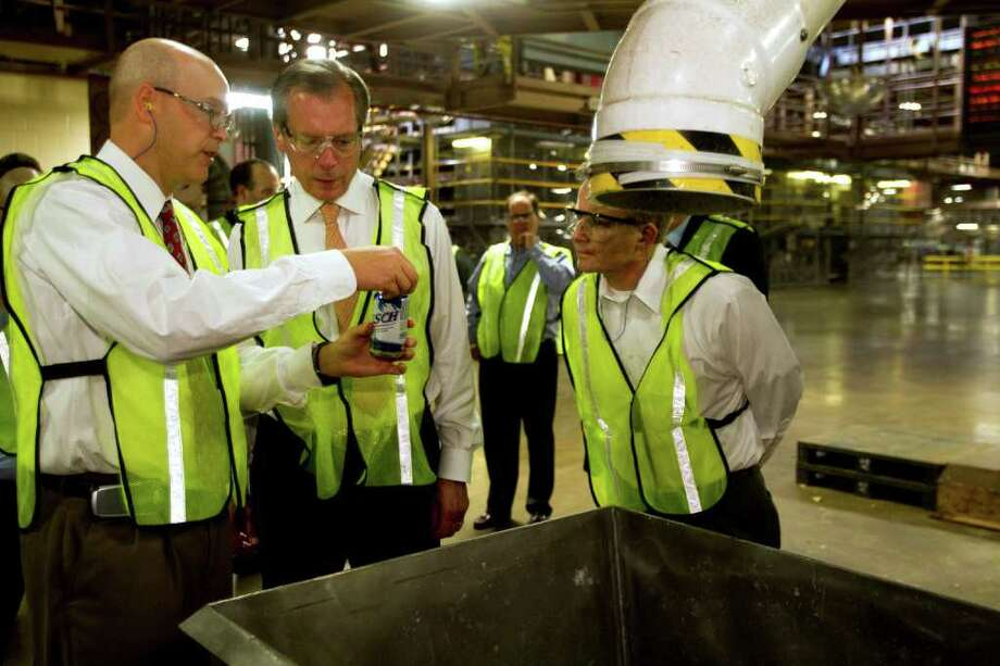 Richard Wohlfarth, general manager of the Anheuser-Busch Houston Brewery, shows Lt. Gov. David Dewhurst, center, some of their recycling efforts during a tour of the brewery Wednesday, Oct. 5, 2011, in Houston. Mark Bordas is shown on the right. ( Brett Coomer / Houston Chronicle ) Photo: Brett Coomer / © 2011 Houston Chronicle