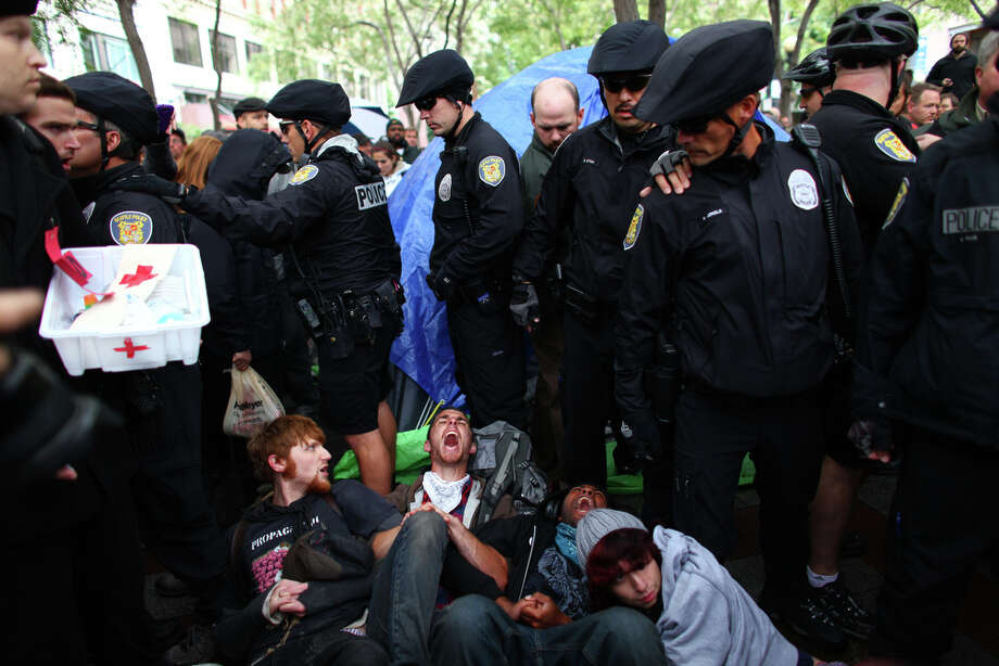 Seattle police officers attempt to remove protesters from Westlake Park. Photo: JOSHUA TRUJILLO / SEATTLEPI.COM