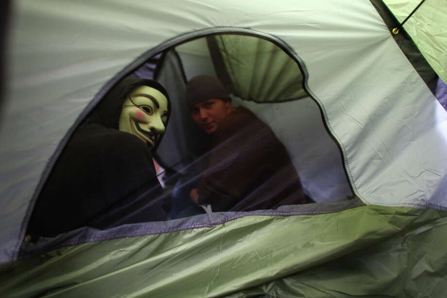 Protesters wait to be arrested in a tent. Photo: JOSHUA TRUJILLO / SEATTLEPI.COM