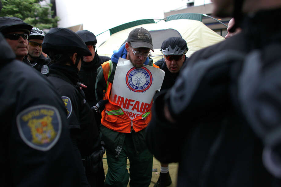 A protester is arrested. Photo: JOSHUA TRUJILLO / SEATTLEPI.COM