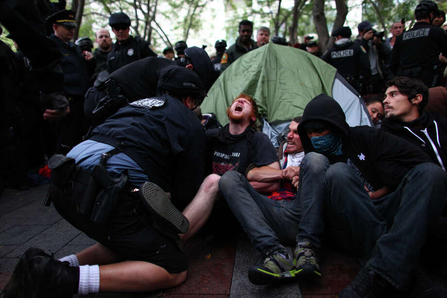 Protesters attempting to surround a tent are removed. Photo: JOSHUA TRUJILLO / SEATTLEPI.COM