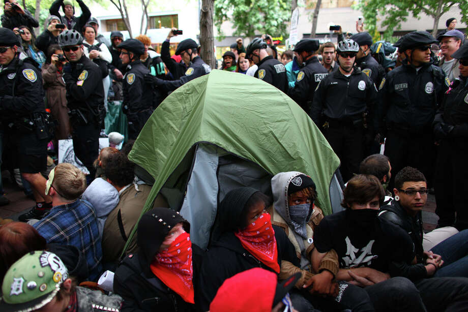Protesters attempt to form a barrier around a tent. Photo: JOSHUA TRUJILLO / SEATTLEPI.COM