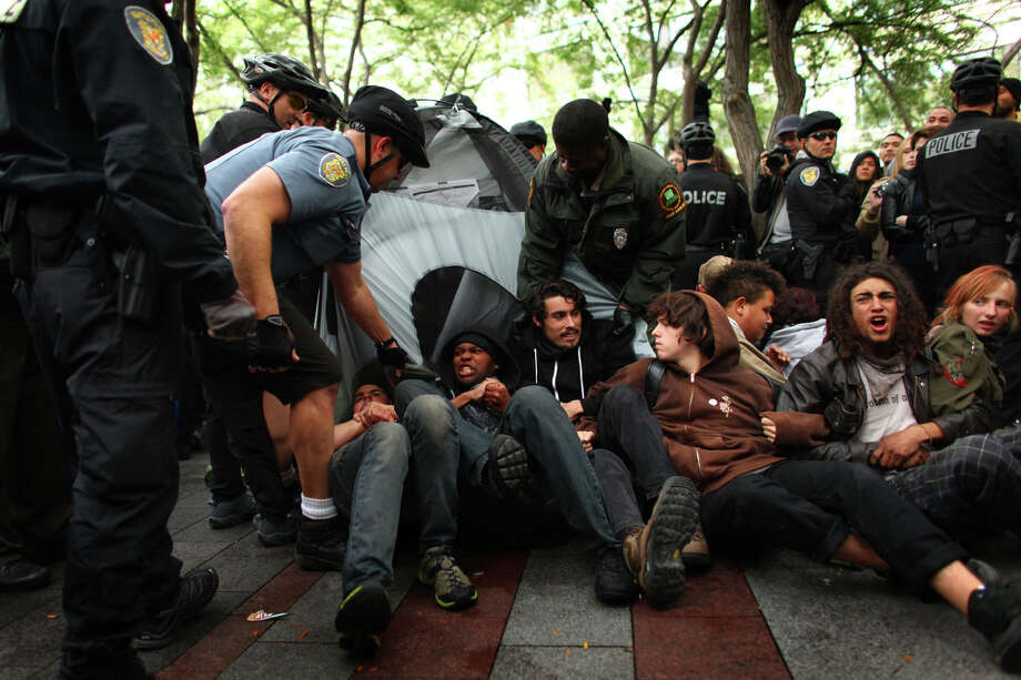 Protesters attempt to prevent officers from removing a tent. Photo: JOSHUA TRUJILLO / SEATTLEPI.COM