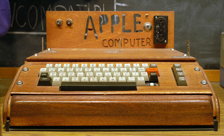 "The Apple I (1976): Only around 200 Apple I computers were produced; all were hand-built by Apple co-founder Steve Wozniak. Jobs handled the distribution and marketing of the Apple I, devising a clever advertising tagline: ""Byte into an Apple."" Photo: Photo Via Ed Uthman/Wikipedia Creative Commons"