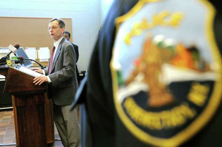 Director Robert Worden of John Finn Institute, left, talks about a customer service survey program for the police department on Wednesday, Oct. 5, 2011, at the Schenectady Police Station in Schenectady, N.Y. (Cindy Schultz / Times Union) Photo: Cindy Schultz