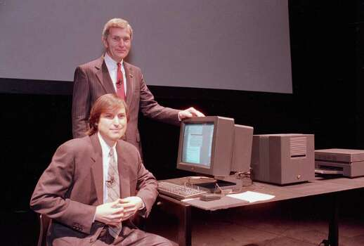 FILE - In this March 30, 1989, file photo, Steve Jobs of NeXT Computer Inc., left, and David Norman, president of Businessland, pose beside a NeXT work station in San Francisco, Calif. Apple on Wednesday, Oct. 5, 2011 said Jobs has died. He was 56. (AP Photo/Paul Sakuma, File) Photo: Paul Sakuma, Associated Press / AP1989