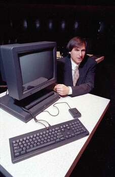 FILE - In this Sept. 18, 1990, file photo, Steve Jobs, president and CEO of NeXT Computer Inc., shows off his company's new NeXTstation after an introduction to the public in San Francisco. Apple on Wednesday, Oct. 5, 2011 said Jobs has died. He was 56. (AP Photo/Eric Risberg, File) Photo: Eric Risberg, Associated Press / AP1990