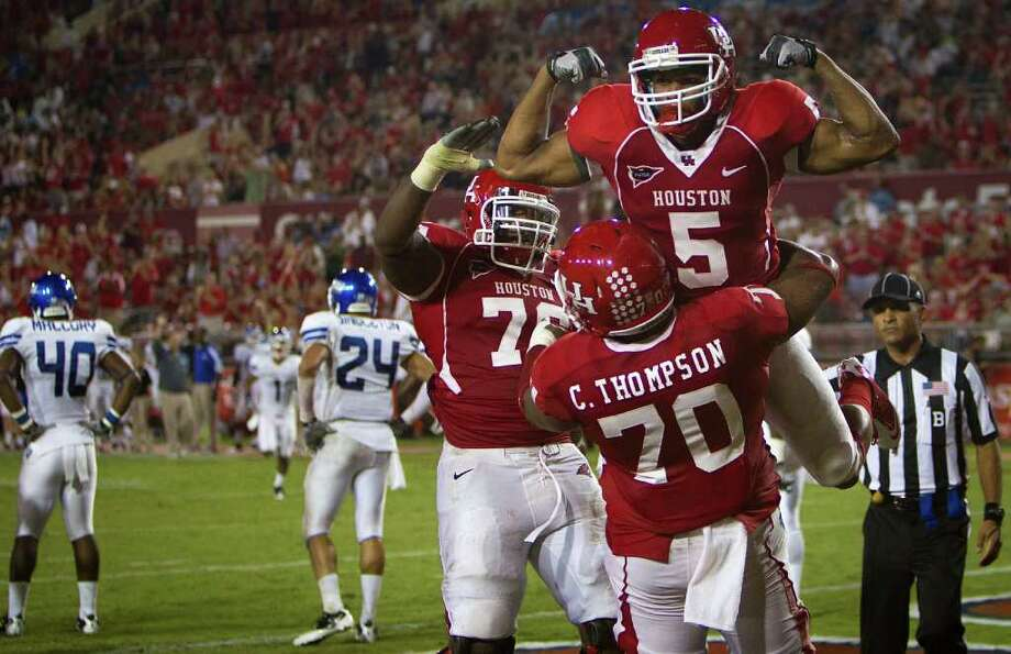 With weapons like running back Charles Sims (5), UH can flex its muscles offensively and pour on the points like few teams. Photo: Smiley N. Pool / © 2011  Houston Chronicle