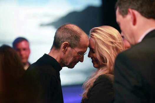 Steve Jobs, Apple CEO, leans his forehead against his wife, Laurene Powell Jobs, forehead after delivering the keynote address to the Apple Worldwide Developers Conference at Moscone West in San Francisco, Calif., Monday, June 6, 2011. Ran on: 08-25-2011 Steve Jobs leans on wife Laurene Powell Jobs at the Worldwide Developers Conference in June. Ran on: 08-25-2011 Steve Jobs leans on wife Laurene Powell Jobs at the Worldwide Developers Conference in June. Ran on: 08-25-2011 Steve Jobs leans on wife Laurene Powell Jobs at the Worldwide Developers Conference in June. Photo: Lea Suzuki, The Chronicle / ONLINE_YES
