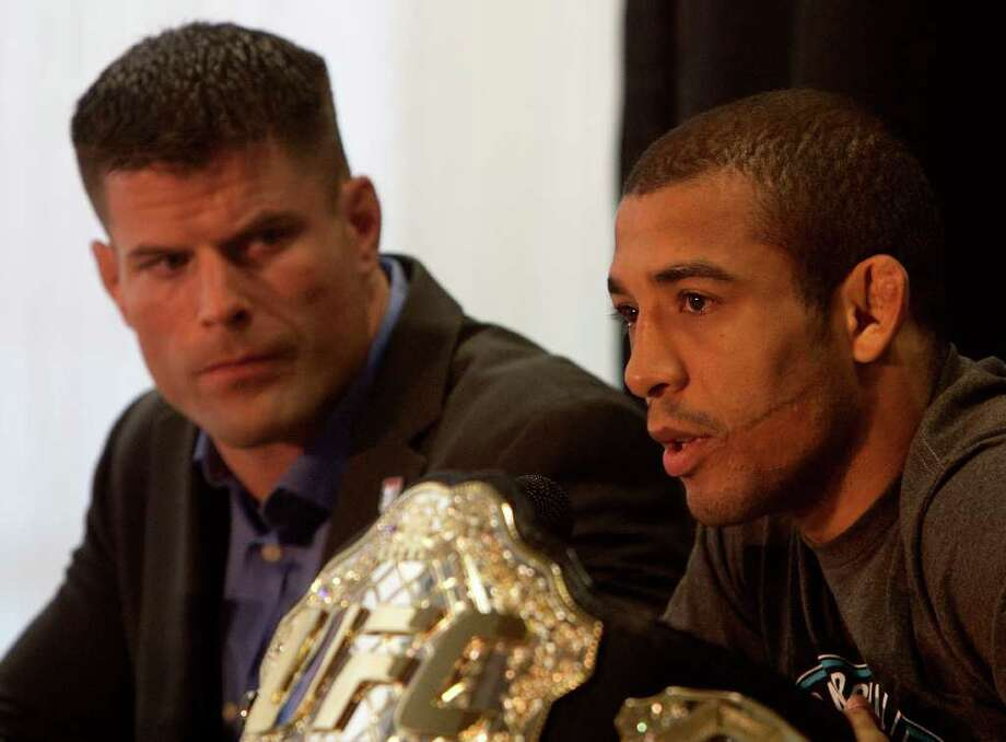 Featherweight champion Jose Aldo, right, answers questions as middleweight contender Brian Stann listens. Photo: Cody Duty, Houston Chronicle / © 2011 Houston Chronicle