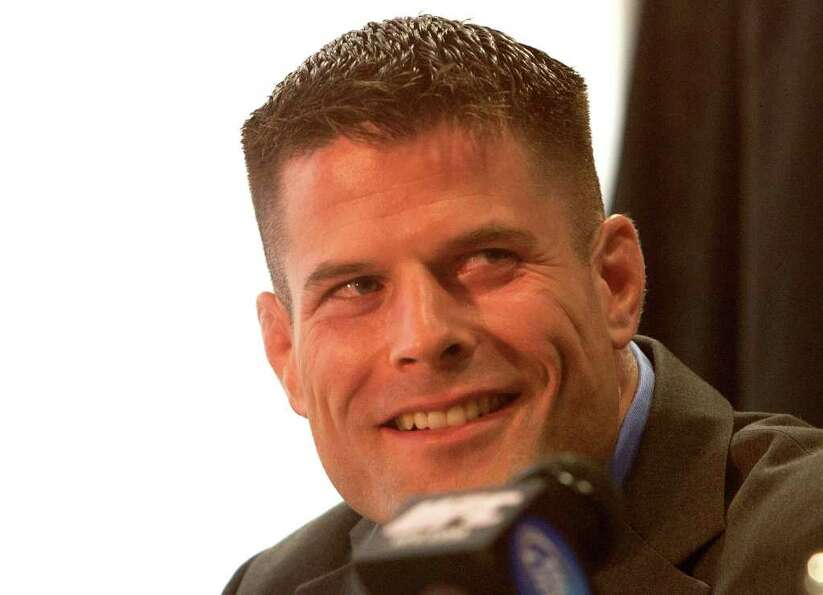 Middleweight contender Brian Stann smiles as his opponent Chael Sonnen (not pictured) speaks.