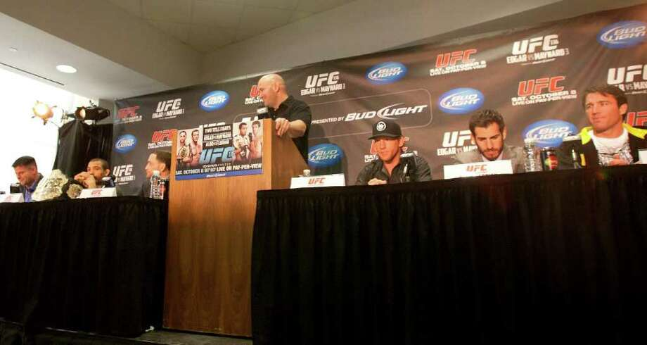 From left: UFC fighters Brian Stann, Jose Aldo, Frankie Edgar, UFC president Dana White, Gray Maynard, Kenny Florian and Chael Sonnen, prepare to answer questions. Photo: Cody Duty, Houston Chronicle / © 2011 Houston Chronicle