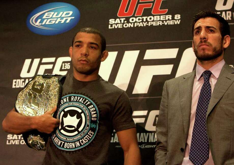 Featherweight champion Jose Aldo, left, stands with contender Kenny Florian. Photo: Cody Duty, Houston Chronicle / © 2011 Houston Chronicle
