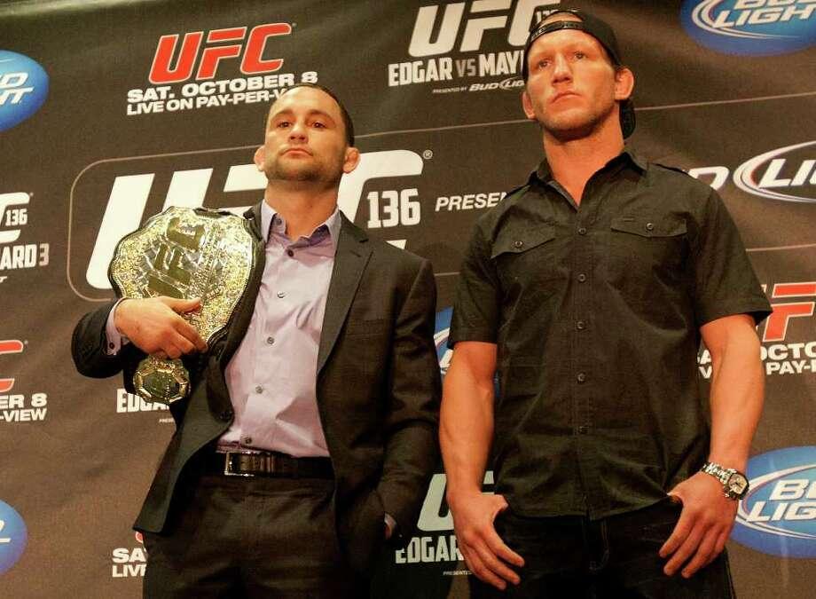 UFC lightweight champion Frankie Edgar, left, stands with contender Gray Maynard. Photo: Cody Duty, Houston Chronicle / © 2011 Houston Chronicle