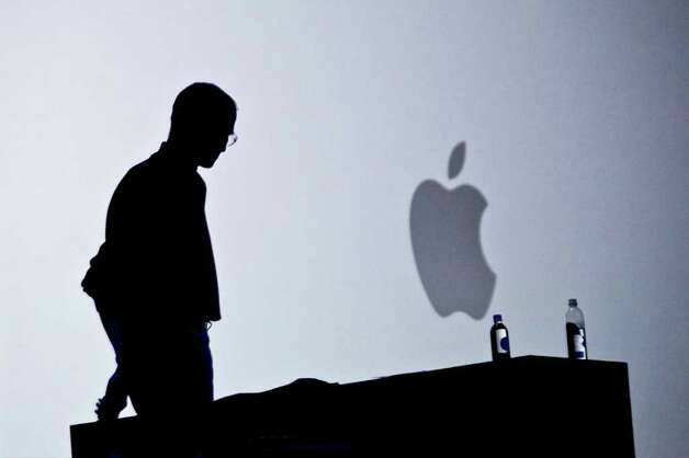 "(FILES): This June 7, 2010 file photo shows Apple chief executive Steve Jobs introducing the iPhone 4 during the keynote address at the Apple Worldwide Developers Conference in San Francisco, California. Apple on Wednesday, October 5, 2011 announced the death of its visionary co-founder Steve Jobs from cancer at 56.  ""We are deeply saddened to announce that Steve Jobs passed away today,"" the company's board of directors said in a statement.      AFP PHOTO / Files / Ryan Anson (Photo credit should read Ryan Anson/AFP/Getty Images) Photo: RYAN ANSON / AFP"