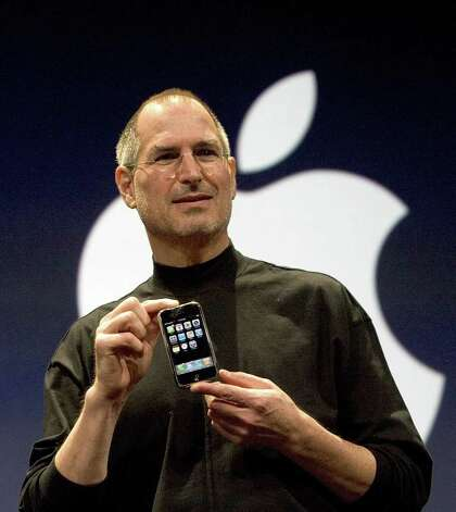 DAVID PAUL MORRIS : GETTY IMAGES game changers: Apple CEO Steve Jobs died Oct. 5 after a long battle with pancreatic cancer. He was known for his obsessive control over his company, but gave Walter Isaacson free rein while writing his biography. Photo: David Paul Morris / 2007 Getty Images