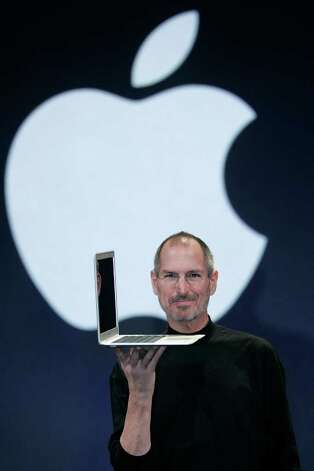 SAN FRANCISCO - FILE:  Apple CEO and co-founder Steve Jobs holds up the new Mac Book Air after he delivered the keynote speech to kick off the 2008 Macworld at the Moscone Center on January 15, 2008 in San Francisco, California. Jobs, 56, passed away October 5, 2011 after a long battle with pancreatic cancer. Jobs co-founded Apple in 1976 and is credited, along with Steve Wozniak, with marketing the world's first personal computer in addition to the popular iPod, iPhone and iPad.  (Photo by David Paul Morris/Getty Images) Photo: David Paul Morris / 2008 Getty Images