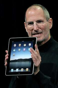 SAN FRANCISCO - FILE:  (EDITORS NOTE: Retransmission with alternate crop.) Apple Inc. CEO Steve Jobs holds up the new iPad as he speaks during an Apple Special Event at Yerba Buena Center for the Arts January 27, 2010 in San Francisco, California. Jobs, 56, passed away October 5, 2011 after a long battle with pancreatic cancer. Jobs co-founded Apple in 1976 and is credited, along with Steve Wozniak, with marketing the world's first personal computer in addition to the popular iPod, iPhone and iPad.  (Photo by Justin Sullivan/Getty Images) Photo: Justin Sullivan / 2010 Getty Images