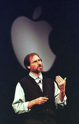 "(FILES): This November 10, 1997 file photo shows Apple co-founder Steve Jobs speaking at a press conference in Cupertino, CA.  Apple on Wednesday, October 5, 2011 announced the death of its visionary co-founder Steve Jobs from cancer at 56.   ""We are deeply saddened to announce that Steve Jobs passed away today,"" the company's board of directors said in a statement.      AFP PHOTO / Files / John G. MABANGLO (Photo credit should read JOHN G. MABANGLO/AFP/Getty Images) Photo: JOHN G. MABANGLO / AFP"