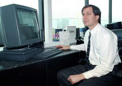 FILE - In this April 4, 1991, file photo, Steve Jobs, of NeXT Computer Inc., poses with his NeXTstation color computer for the press at the NeXT facility in Redwood City, Calif. Apple on Wednesday, Oct. 5, 2011 said Jobs has died. He was 56. (AP Photo/Ben Margot, File) Photo: Ben Margot / AP1991