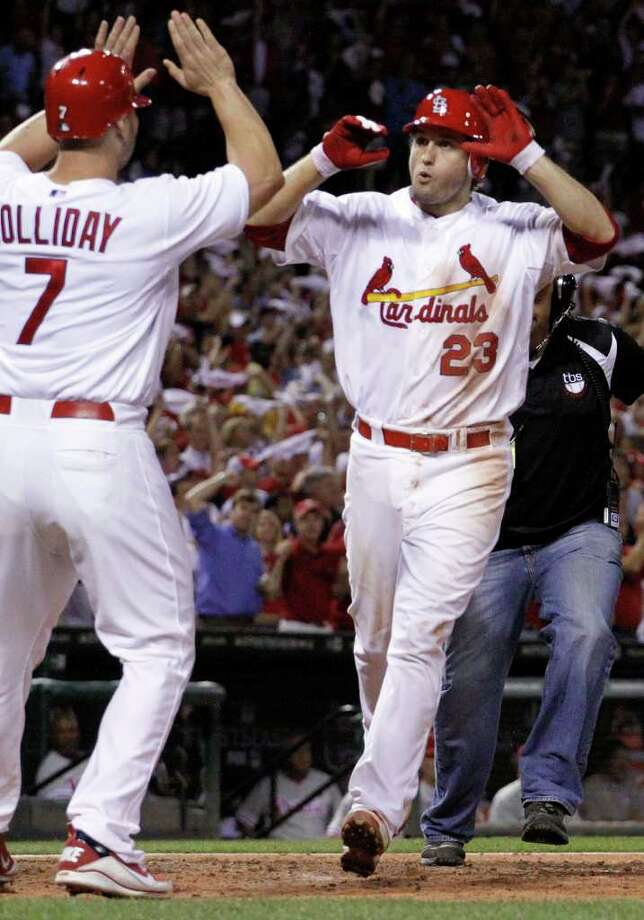 St. Louis Cardinals' David Freese, right, is congratulated by teammate Matt Holliday after hitting a two-run home run during the sixth inning of Game 4 of baseball's National League division series against the Philadelphia Phillies, Wednesday, Oct. 5, 2011, in St. Louis. (AP Photo/Jeff Roberson) Photo: Jeff Roberson