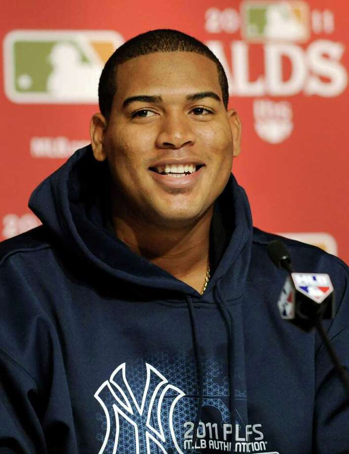 New York Yankees pitcher Ivan Nova speaks to the media during a baseball news conference, Wednesday, Oct. 5, 2011, at Yankee Stadium in New York. The Yankees are scheduled to play the Detroit Tigers in Game 5 of baseball's American League division series on Thursday.  (AP Photo/Bill Kostroun) Photo: Bill Kostroun