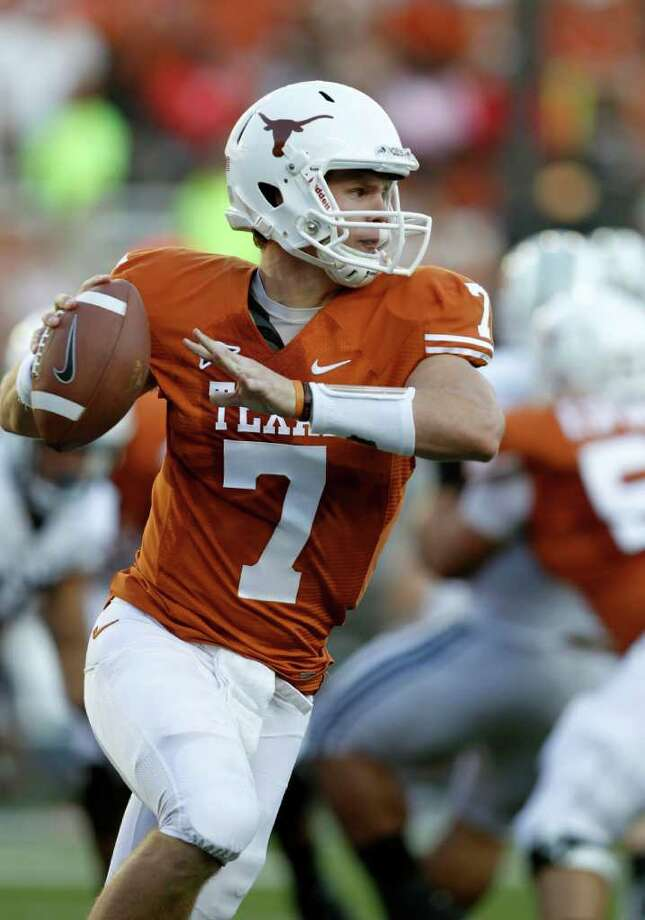 ERICH SCHLEGEL : GETTY  INCOMPLETE: Garrett Gilbert looks for a receiver against BYU in what turned out to be his final game at UT. Photo: Erich Schlegel / 2011 Getty Images
