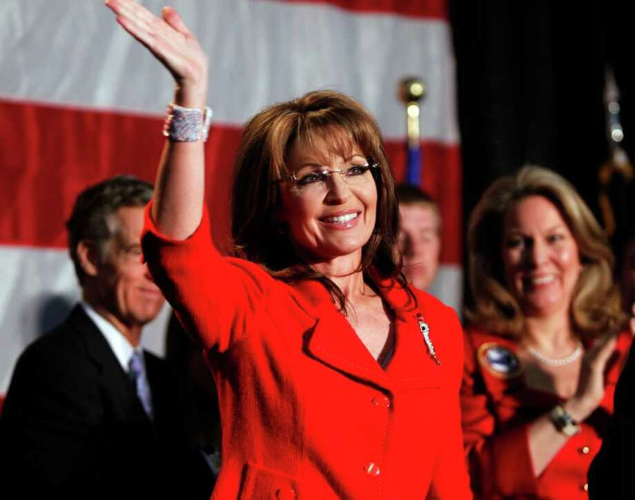 """FILE - In this May 2, 2011, file photo, former Alaska Governor Sarah Palin waves during a fundraiser at Colorado Christian University in Lakewood, Colo. Palin has authorized a feature-length film about her rise, added staff and recently said she has """"that fire in the belly"""" for a presidential bid,  all steps that fuel speculation she's inching toward a White House run. (AP Photo/Ed Andrieski) Photo: Ed Andrieski"""