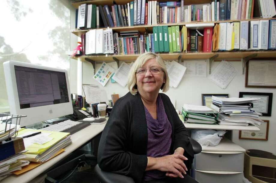 This Tuesday, Oct. 4, 2011 photo shows Debbie Wingard in her office at the University of California-San Diego where she is a professor. Wingard has had breast cancer twice and has been unable to conceive which she believes is due to her mother's use of the drug DES during pregnancy. The drug that millions of pregnant women took decades ago to prevent miscarriage and complications has put their daughters at higher risk for breast cancer and other health problems that are showing up now, a new federal study finds. (AP Photo/Lenny Ignelzi) Photo: Lenny Ignelzi