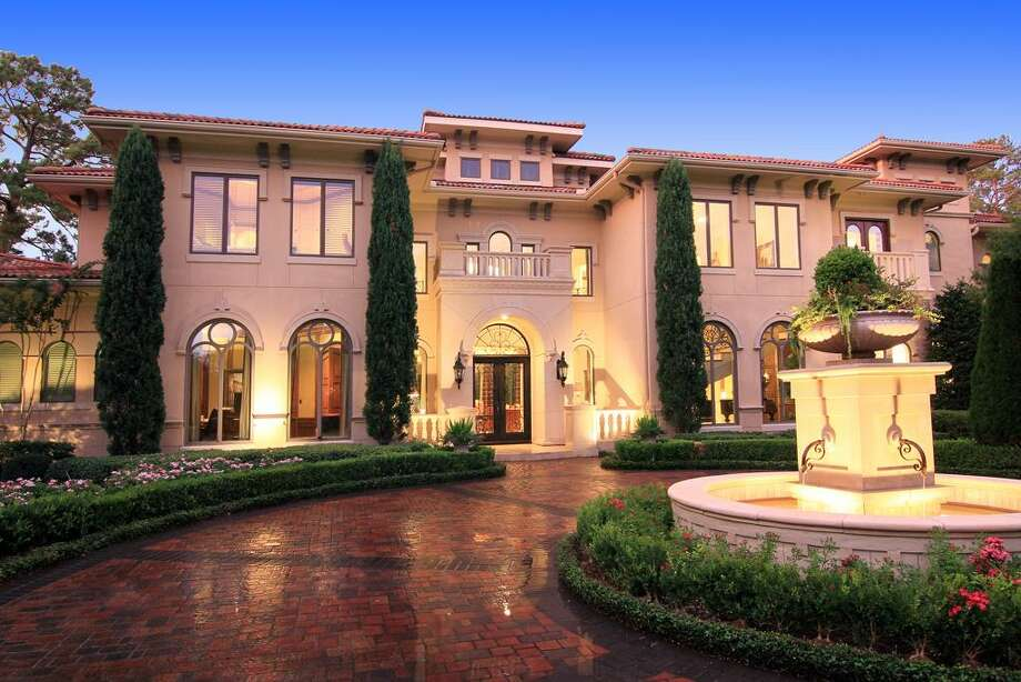 An external view of the front of the home, spotlighting the fountain.  Photo: RealEstate.MarthaTurner.com