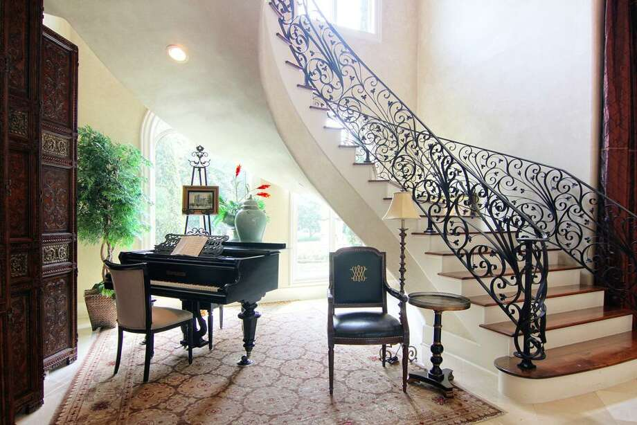 The floating staircase winds its way upstairs in a beautiful fashion.  Photo: RealEstate.MarthaTurner.com