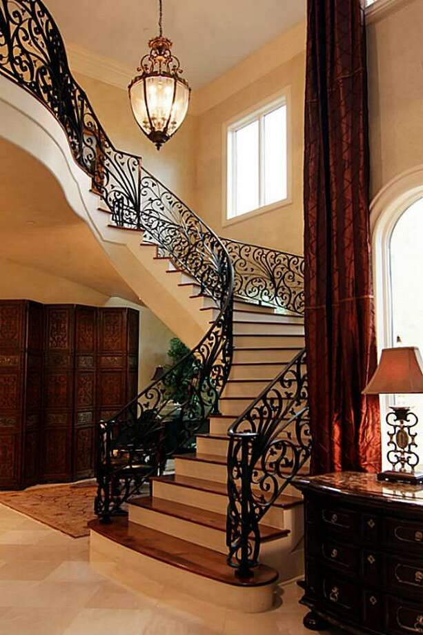 The European-style chandelier proves ample light as you climb the  stairs. Photo: RealEstate.MarthaTurner.com