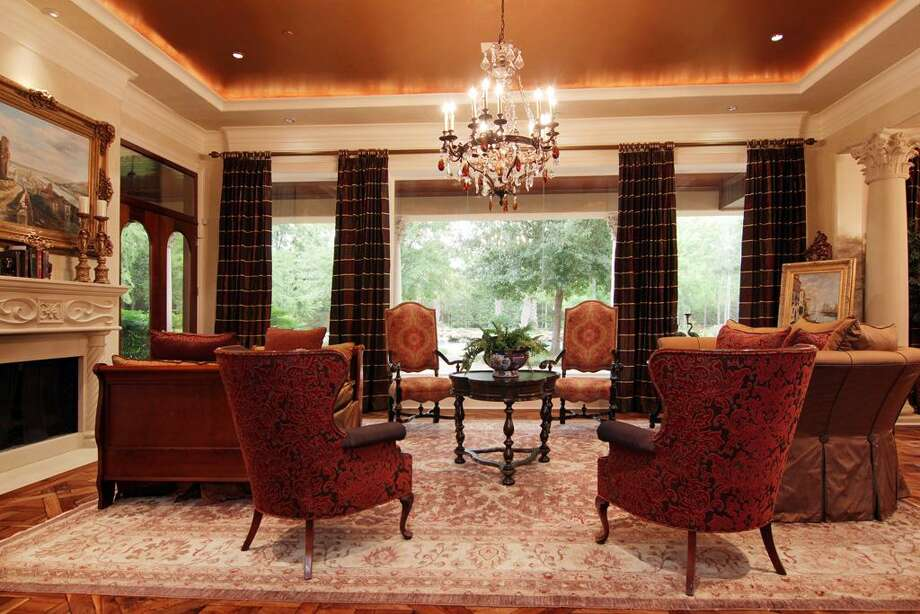 The formal living room features a fireplace, chandelier and easy access to the  veranda. Photo: RealEstate.MarthaTurner.com