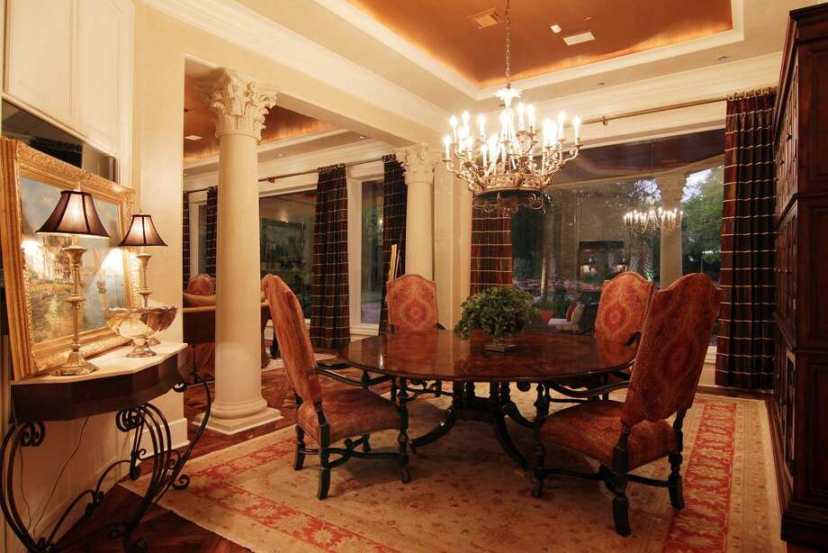 The formal dining room features hardwood floors and Corinthian columns.  Photo: RealEstate.MarthaTurner.com