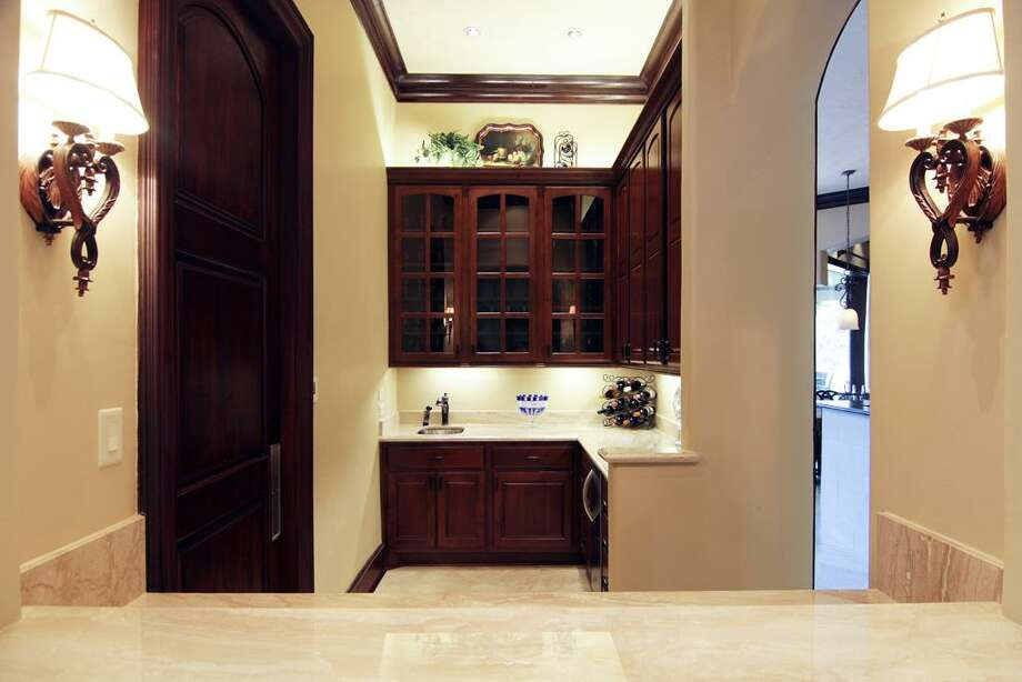 The butler's pantry includes elegant cabinets and granite countertops.  Photo: RealEstate.MarthaTurner.com