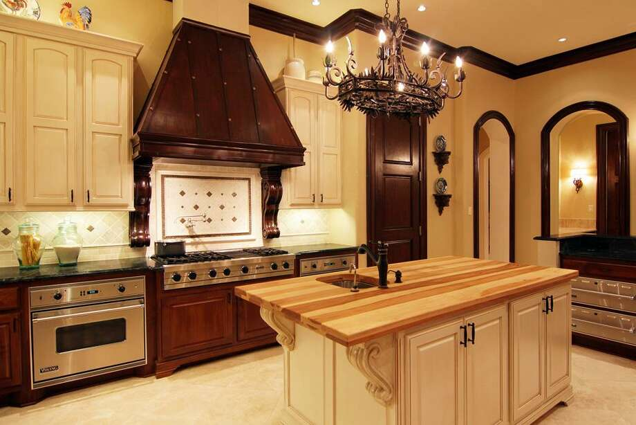 The cook's kitchen features considerable cabinet and counter space, the latter  aided by the center island.  Photo: RealEstate.MarthaTurner.com