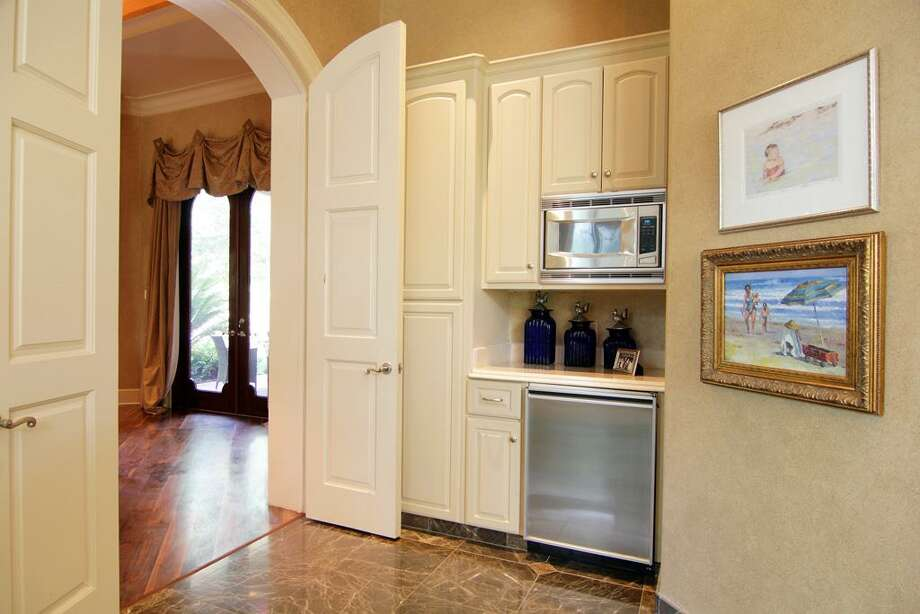 The master bathroom even includes a juice bar, with refrigerator and  microwave. Photo: RealEstate.MarthaTurner.com
