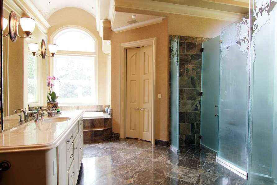 A closer look at the double marble shower.