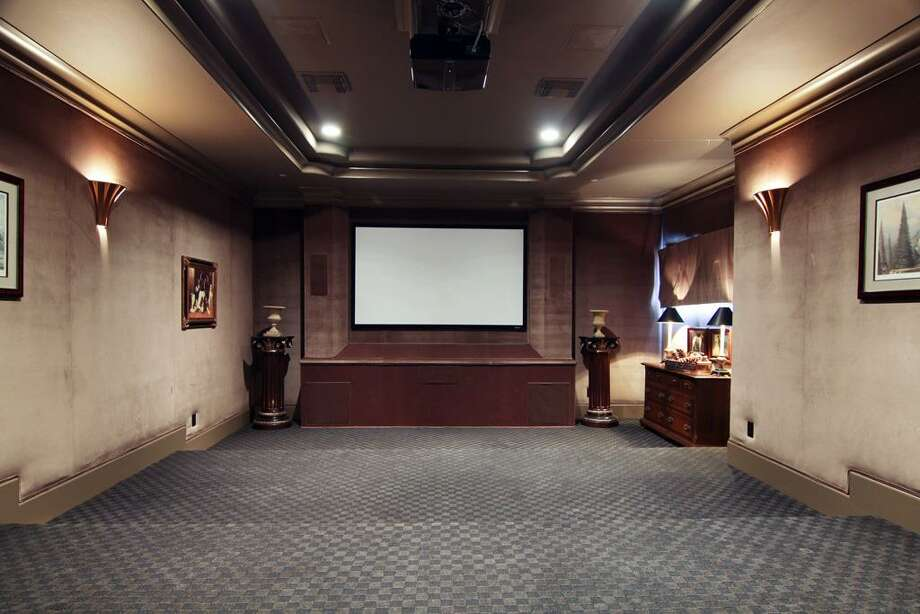 The home theater provides the movie-going experience without ever leaving the comfort of home. Photo: RealEstate.MarthaTurner.com