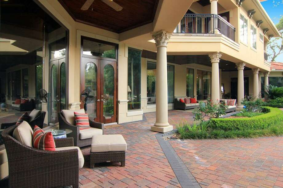The covered veranda runs along the rear of the home and is easily accessible from several rooms. Photo: RealEstate.MarthaTurner.com